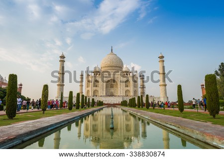 A perspective view on Taj-Mahal mausoleum in evening. - stock photo