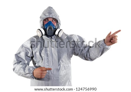A pest control worker wearing a mask, hood, protective suit and dual air filters to help exterminate rats and other vermin. - stock photo