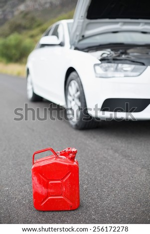 A petrolcan next to car after a breakdown at the side of the road - stock photo