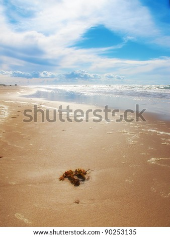 A photo of a beach late afternoon a sunny day - stock photo