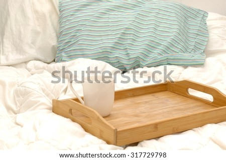 A photo of a breakfast tray in bed - stock photo