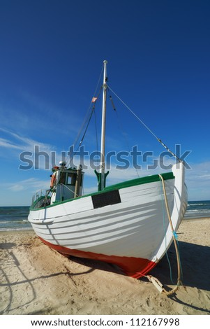 A photo of a Danish fishing boat at the beach - stock photo