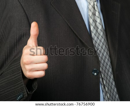 A photo of a hand doing a thumb up gesture. Focus on thumb - stock photo