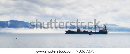 A photo of a large cargo ship by the coast of New Zealand - stock photo