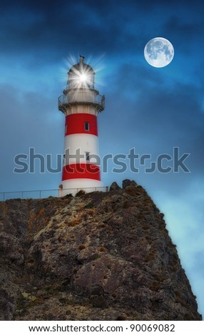 A photo of a lighthouse at night in New Zealand - stock photo