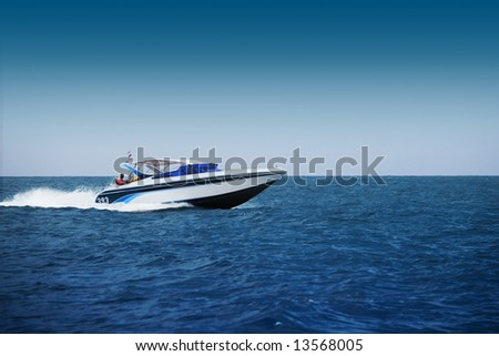 A photo of a speed motor boat - stock photo