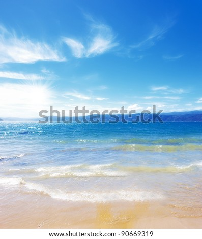 A photo of a Tropical beach and ocean - stock photo