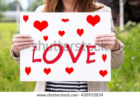 a photo of a woman with a piece I love you - stock photo