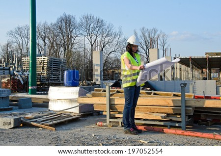 a photo of a young woman architect on the building site of the construction project - stock photo
