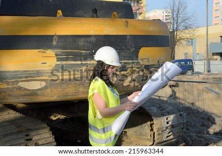 a photo of a young woman architect on the building site of the construction project