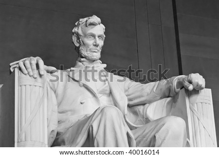A photo of Abraham Lincoln's statue inside the Lincoln Memorial. Located on the National Mall in Washington DC. - stock photo