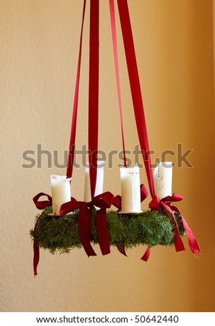 A photo of Advent wreath with big white candles - stock photo