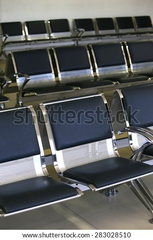 A photo of airport lounge row seating - stock photo