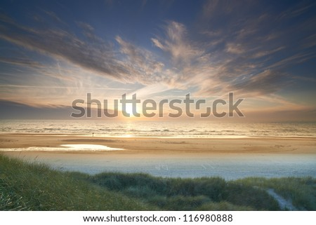A photo of beach sunrise - Jutland, Denmark