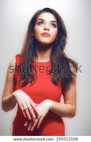A photo of beautiful girl is in fashion style.Beautiful woman with elegant dress posing in studio. Fashion photo - stock photo