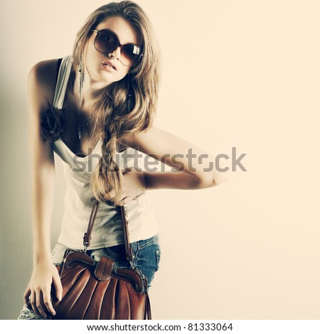 A photo of beautiful girl is in style of pinup, glamour - stock photo