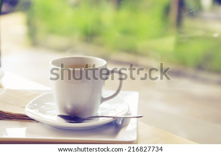 a photo of black coffee in white mug on table with texture - stock photo