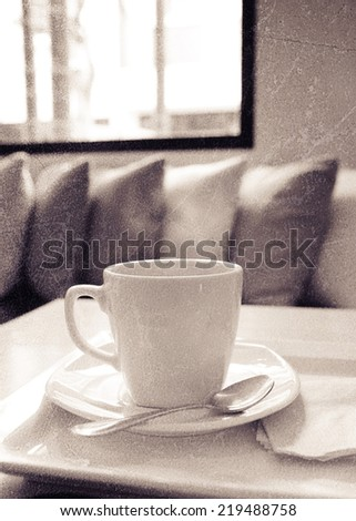 a photo of coffee in white mug on table with texture - stock photo