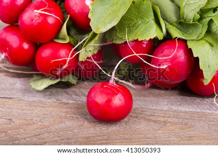 a photo of fresh red radishes