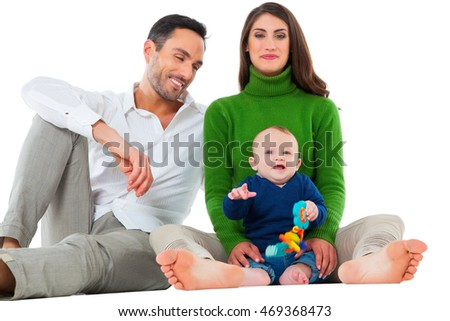 A photo of happy parents with baby boy. Family of three are spending leisure time together. They are in casuals isolated over white background.