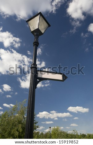 a photo of lantern with arrow sign