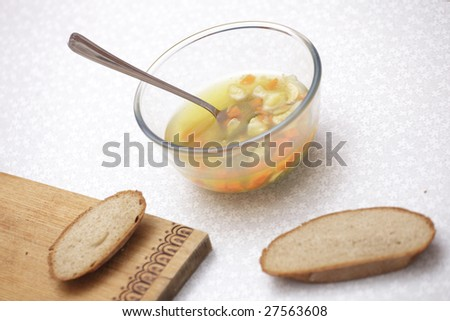 a photo of plate of with soup