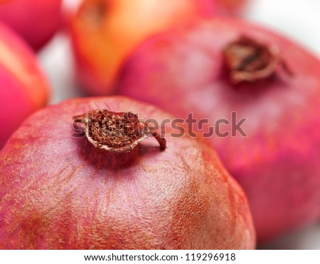 A photo of Ripe pomegranates in natural colors - stock photo