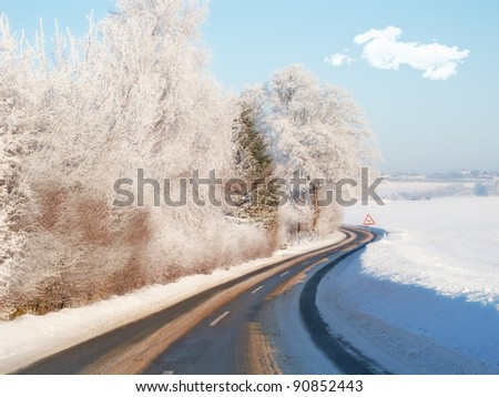 A photo of road in winter landscape - stock photo