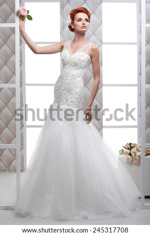 A photo of sexual beautiful bride in a wedding-dress is in fashion style. Wedding decorations - stock photo