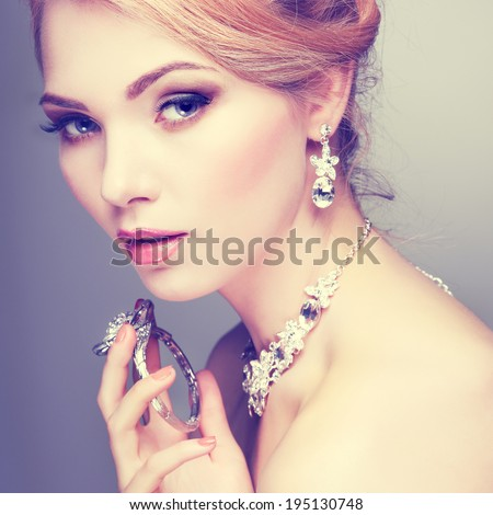 A photo of sexual beautiful girl in a wedding-dress is in fashion style. Wedding decorations - stock photo