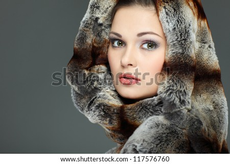 A photo of sexual beautiful girl is in fur clothes - stock photo