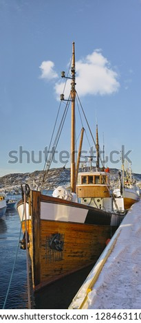 A photo of small Norwegian harbor North of the Polar Circle, Bodoe. Wintertime light. - stock photo
