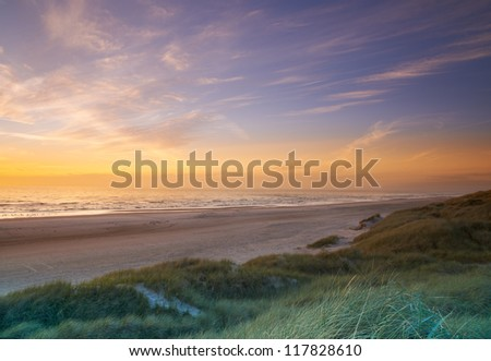 A photo of sunset at the beach - stock photo