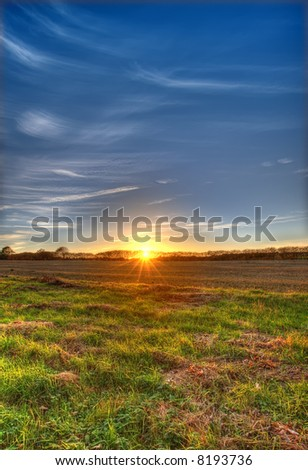 A photo of sunset at the countryside (HDR photo, made from three different exposures). - stock photo