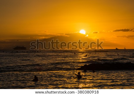 A photo of sunset in Waikiki, Honolulu, Hawaii with a yacht on the horizon