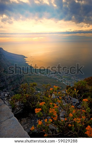 A photo of sunset seen from Table Mountain, Cape town, South Africa. - stock photo