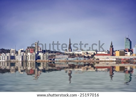 A photo of the swedish town of vasteras from the water.
