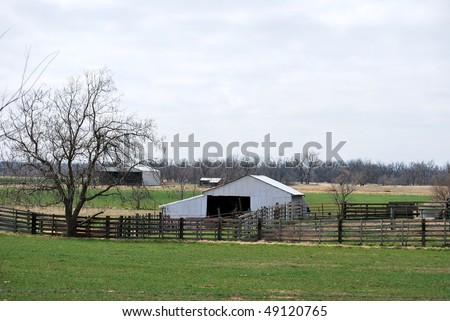 A photograph of a barn in a Oklahoma field. - stock photo