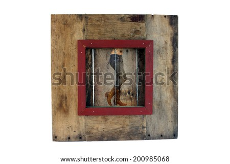 A photograph of a female lower torso wearing denim jeans and cowboy boots, overlaid on real aged and weathered wood.  Generous copyspace. - stock photo