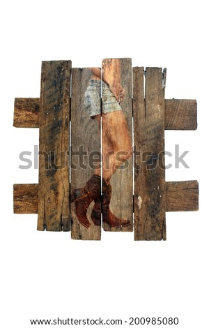 A photograph of a female lower torso wearing denim shorts and cowboy boots, overlaid on real aged and weathered wood.  Generous copyspace. - stock photo