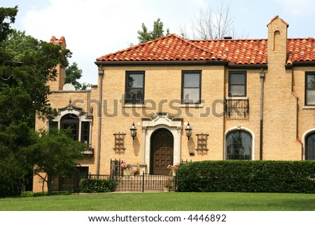 A photograph of a residential home. - stock photo