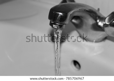 A photograph of a sink with running water