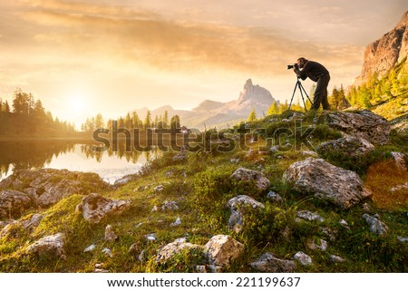 A photographer in the beautiful lake Federa