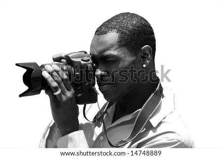 a photographer takes a photo with his digital camera isolated on white in black and white