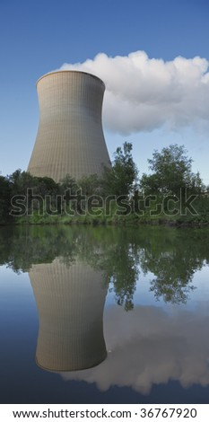 A photography of a cooling tower at the lake - stock photo
