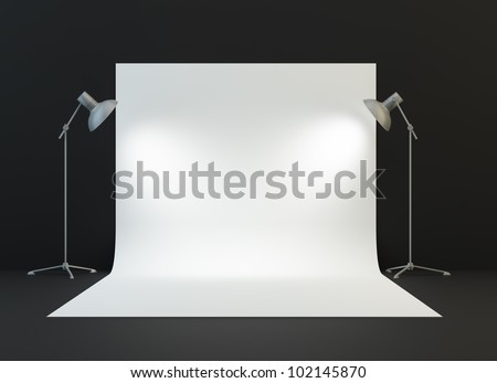A photography studio with a light set-up and backdrop - stock photo