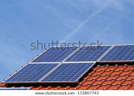 a photovoltaic power plant on the roof of a house