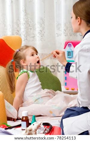 A physician house call. Examines sick girl - stock photo