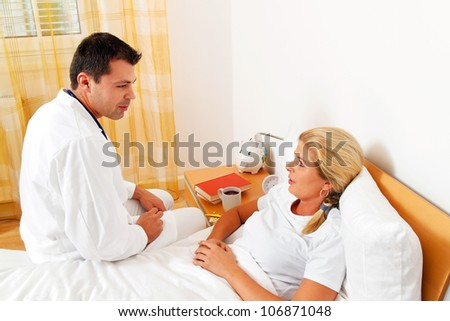 a physician house call. examines sick wife. - stock photo