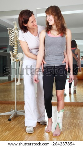 A Physiotherapist and patient with foot injury - stock photo